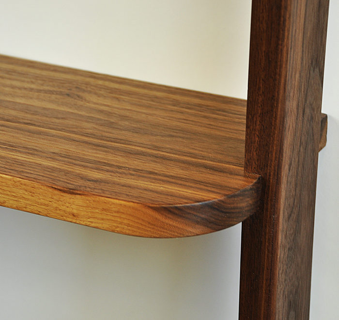 Leaning bookcase walnut bookcase detail