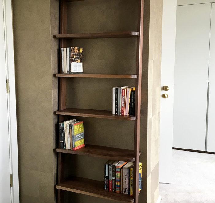 Leaning bookcase walnut bookcase lifestyle