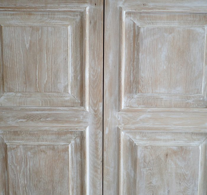 Distressed oak panelled wardrobe doors detail