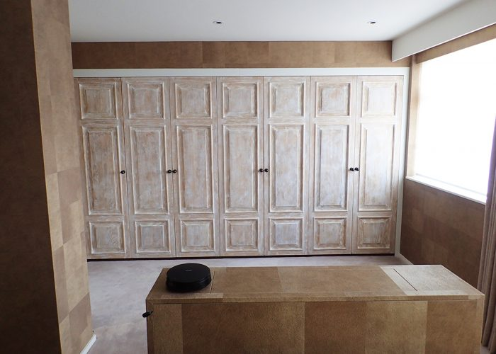 Distressed oak panelled wardrobe doors room