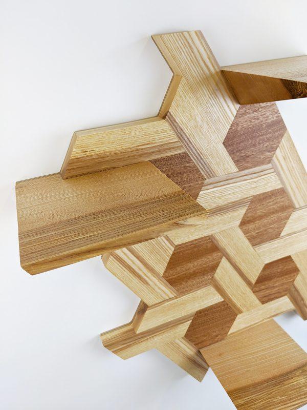 Ash and sapele hexagon shelving detail