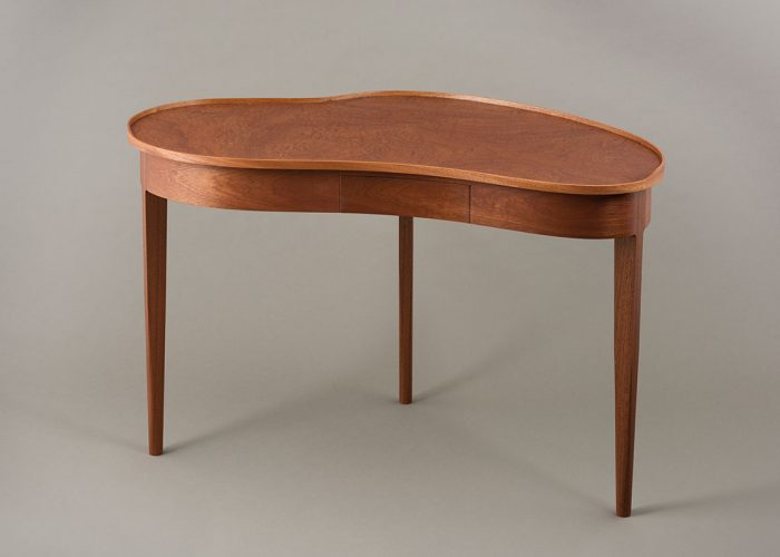 Kidney shaped desk in pommele sapele