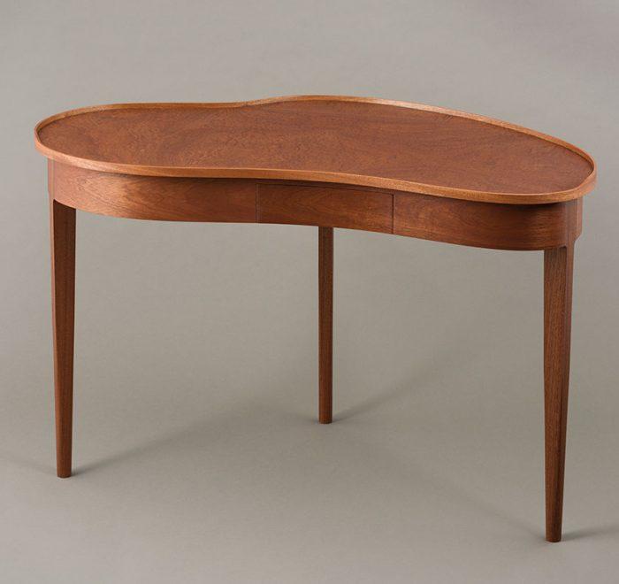 Kidney shaped desk in pommele sapele
